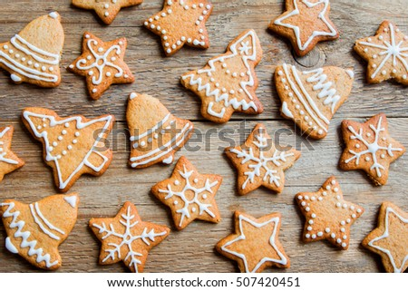 Christmas gingerbread cookies on wooden table - Christmas homemade festive bakery