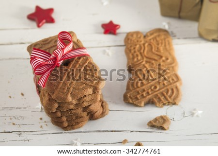 Christmas gingerbread cookies over white table - stock photo