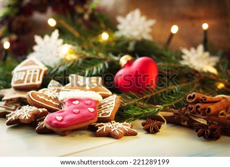 Christmas gingerbread cookies with festive decoration - stock photo