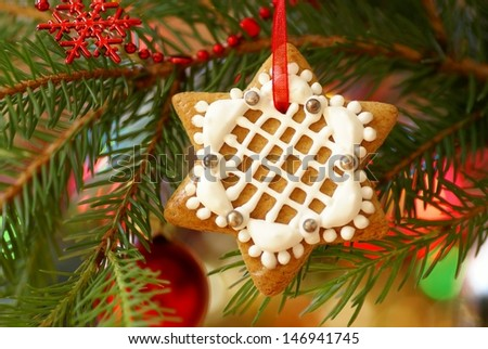 Christmas gingerbread decoration on a tree - stock photo