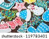 Christmas gingerbread home cooking on a wooden table - stock photo