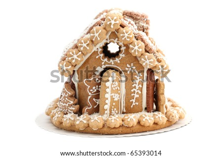 Christmas gingerbread house isolated on white background. Shallow dof - stock photo
