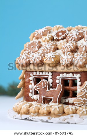 Christmas gingerbread house on blue background. Shallow dof - stock photo