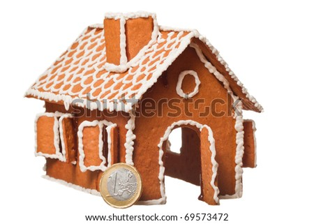 Christmas gingerbread house with Euro coins - stock photo