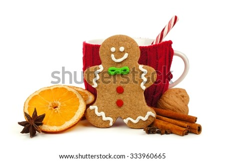 Christmas gingerbread man with festive mug and holiday spices isolated on a white background - stock photo