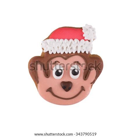 Christmas gingerbread monkey isolated on white background - stock photo
