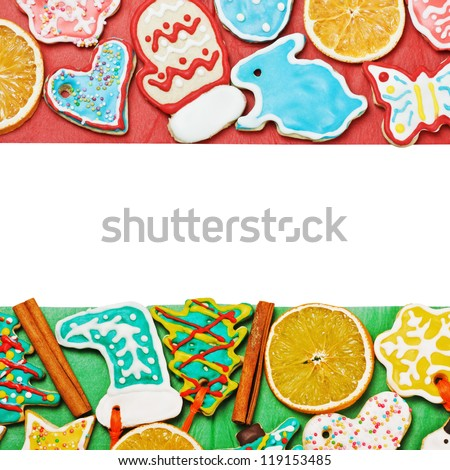 Christmas gingerbread on a red and green background with space for text - stock photo