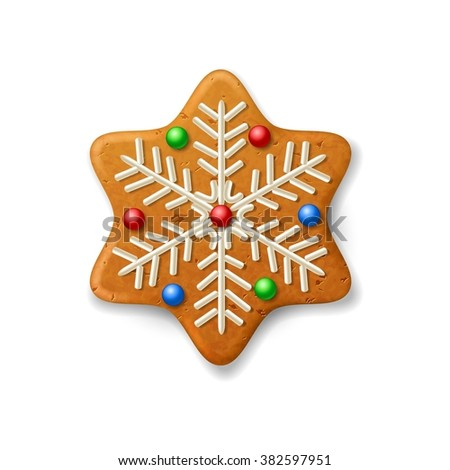 Christmas gingerbread snowflake, decorated colored icing  - stock photo
