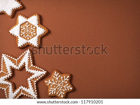 Christmas gingerbread stars on brown paper background. Top view - stock photo