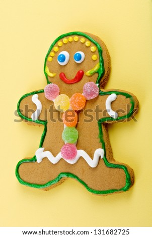 Christmas gingerbread woman with gumdrops and white icing piping for clothes.