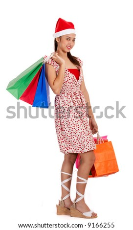 christmas girl holding some colorful shopping bags