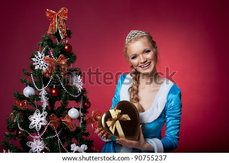 Christmas girl in blue sexy cloth with gift box - stock photo