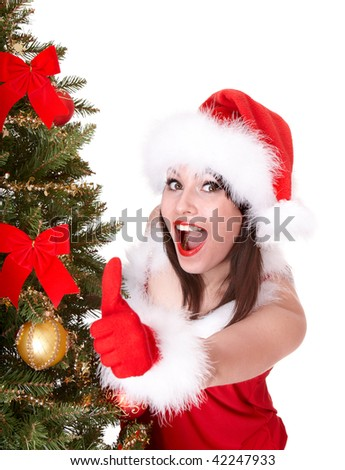 Christmas girl in santa hat and fir tree with  thumb up. Isolated. - stock photo