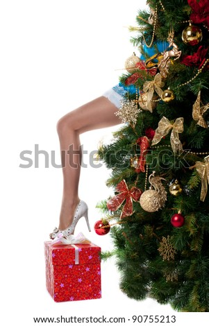 christmas girl show sexy leg from new year tree - stock photo