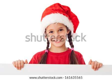 Christmas girl standing with empty horizontal banner in hands, isolated on white - stock photo
