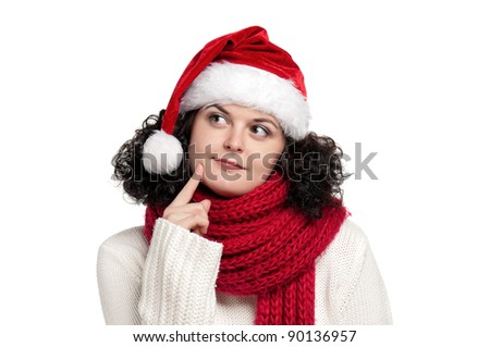 Christmas girl wearing Santa hat in warm sweater and scarf with happy smile posing on white