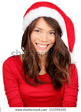 Christmas girl wearing santa hat. Portrait of Asian woman smiling happy on white background. - stock photo