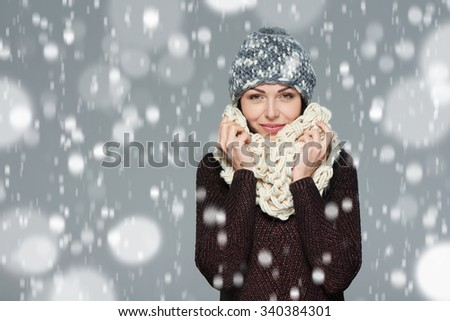 Christmas girl, winter concept. Young beautiful smiling girl over snow background - stock photo
