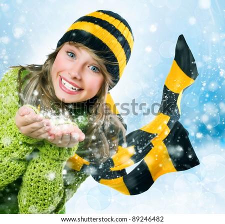 Christmas Girl.Winter Teenage girl Blowing Snow - stock photo