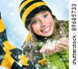 Christmas Girl.Winter Teenage girl Blowing Snow .New Year celebration - stock photo