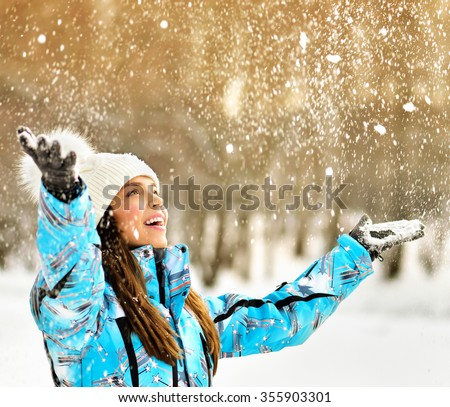Christmas Girl.Winter woman Blowing Snow in frosty winter Park. Outdoors. Flying Snowflakes. - stock photo