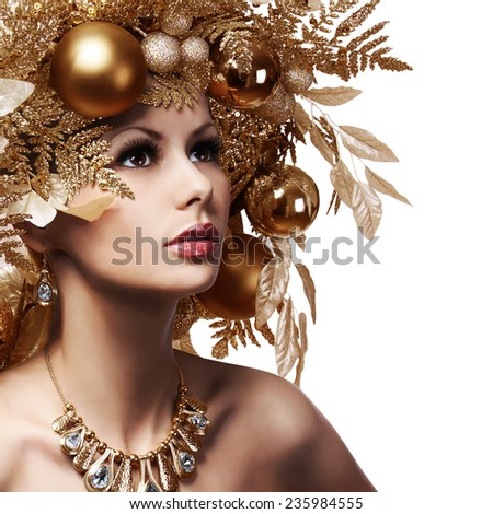 Christmas Girl with Decorated Hairstyle. Portrait of Beautiful Young Woman with Gold Christmas Balls isolated on white background.  - stock photo