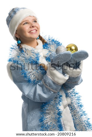 christmas girl with decoration ball in hands looks upward, isolated on white
