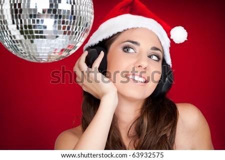 Christmas girl with disco ball listening music - stock photo