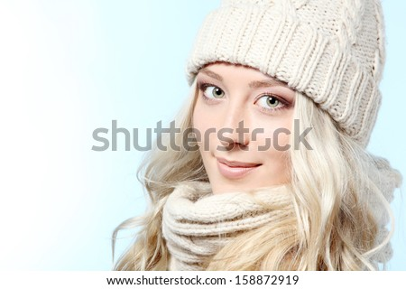 christmas girl, young beautiful smiling and looking at camera over blue background