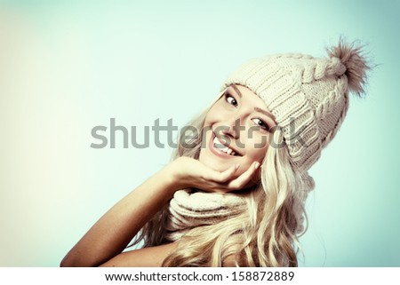 christmas girl, young beautiful smiling and looking at camera over blue background, toned