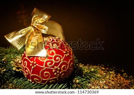 christmas glass ball over dark background - stock photo