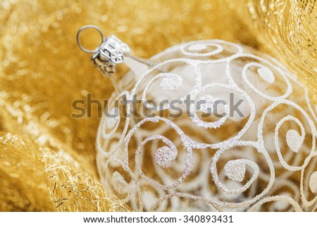 Christmas glass balls, typical Christmas decorations on golden background