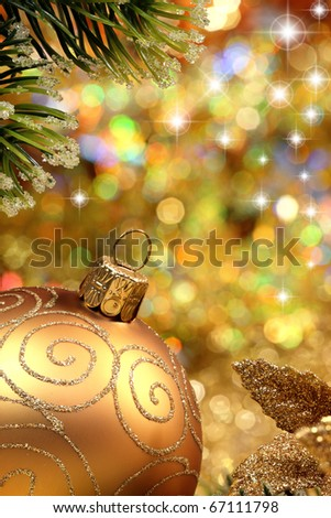 Christmas glitter ball and fir branch as christmas decoration.