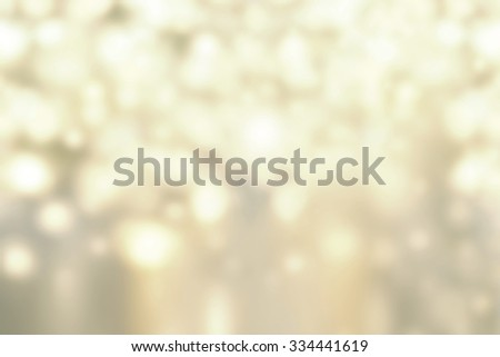 Christmas Gold  bokeh lights background with Defocused golden circles.  - stock photo