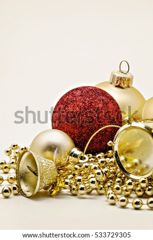 Christmas gold decoration, balls, beads, bell close up isolated.
