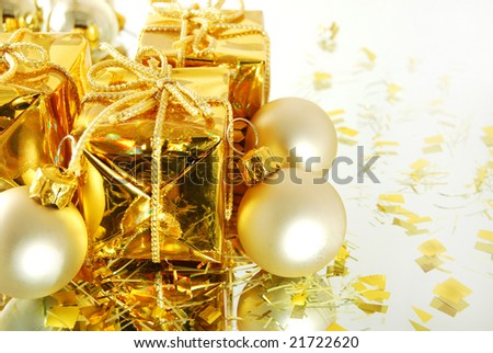 Christmas gold gift and balls on the white background
