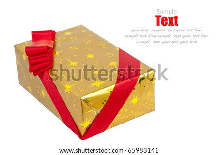 Christmas gold gift box tied with red ribbon bow on white background - stock photo