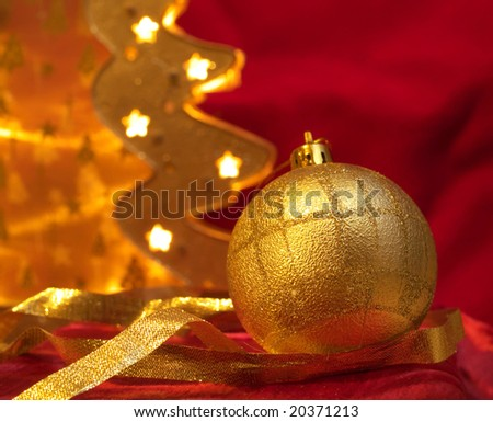 Christmas gold ornaments on the red background - stock photo