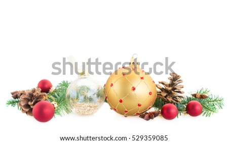 Christmas golden and red balls and evergreen twigs isolated on white background