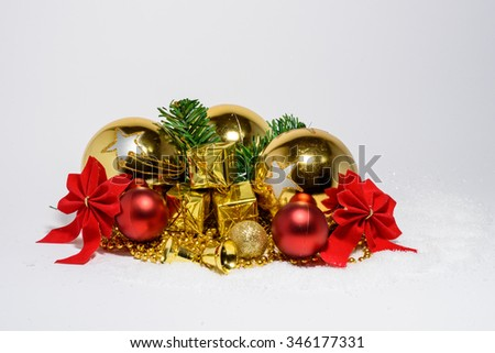 Christmas golden and red toys with white snow