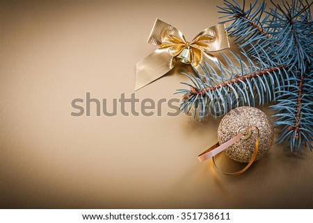 Christmas golden ball bow fir branch holidays concept. - stock photo