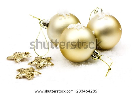 Christmas golden balls and stars with snow on white background - stock photo