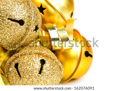 Christmas golden bells and ribbons - stock photo