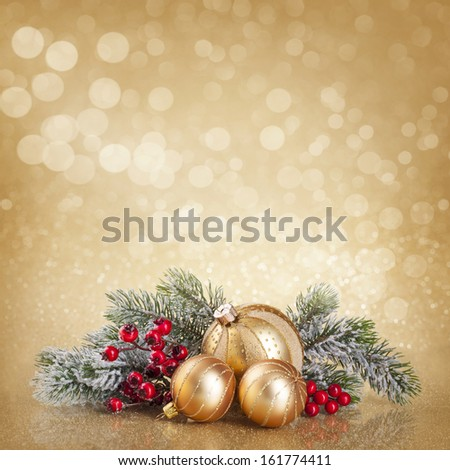 Christmas golden decoration with balls and fir tree - stock photo