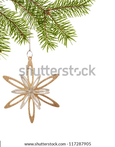 Christmas golden snowflake hanging on a spruce on white background - stock photo