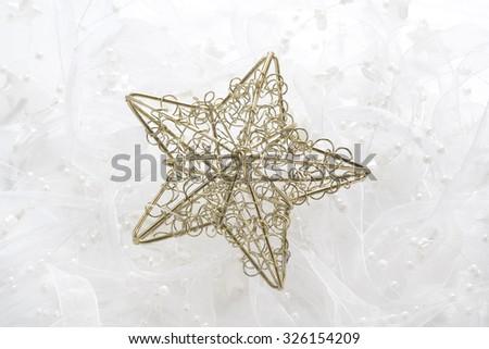 Christmas golden star decor. - stock photo