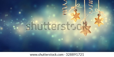 Christmas golden star ornaments at blue night - stock photo