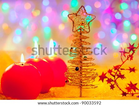 Christmas golden tree with baubles and candles in blur lights - stock photo