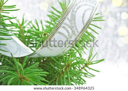 Christmas green tree on shiny background with copy space for text. Christmas background or greeting card. Selective focus. - stock photo