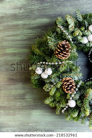Christmas green wreath with decorations - stock photo